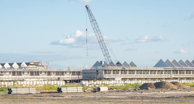 Bezuinigingen bij gemeenten leiden tot rem op bouw nieuwe woningen