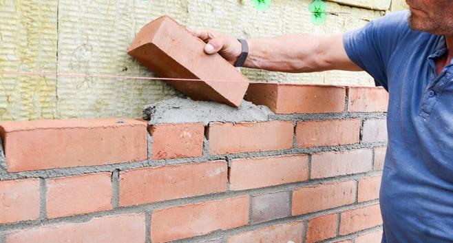 Stijgende prijzen voor grondstoffen zorgen voor stagnatie van woningbouwprojecten
